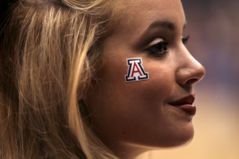 LOS ANGELES, CA - MARCH 12:  A Arizona Wildcats cheerleader watches the championship game of the 2011 Pacific Life Pac-10 Men's Basketball Tournament against the Washington Huskies at Staples Center on March 12, 2011 in Los Angeles, California.  (Photo by