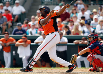 SARASOTA, FL - MARCH 05:  Designated hitter Vladimir Guerrero #27 of the Baltimore Orioles bats against the Boston Red Sox during a Grapefruit League Spring Training Game at Ed Smith Stadium on March 5, 2011 in Sarasota, Florida.  (Photo by J. Meric/Getty