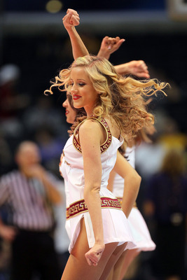LOS ANGELES, CA - MARCH 10:  USC Trojans cheerleaders performs during a break in the game against the California Golden Bears in the quarterfinals of the 2011 Pacific Life Pac-10 Men's Basketball Tournament at Staples Center on March 10, 2011 in Los Angel