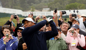 PEBBLE BEACH, CA - JUNE 14:  Patrons photograph Tiger Woods as he plays a tee shot during a practice round prior to the start of the 110th U.S. Open at Pebble Beach Golf Links on June 14, 2010 in Pebble Beach, California.  (Photo by Scott Halleran/Getty I