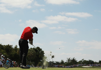 DORAL, FL - MARCH 13:  Tiger Woods hits his tee shot on the fourth hole during the final round of the 2011 WGC- Cadillac Championship at the TPC Blue Monster at the Doral Golf Resort and Spa on March 13, 2011 in Doral, Florida.  (Photo by Mike Ehrmann/Get