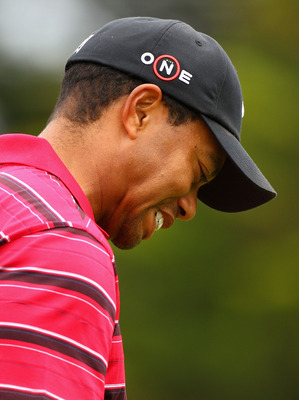 MELBOURNE, AUSTRALIA - NOVEMBER 14:  Tiger Woods of the USA looks dejected after hitting a tee shot during round four of the Australian Masters at The Victoria Golf Club on November 14, 2010 in Melbourne, Australia.  (Photo by Ryan Pierse/Getty Images)