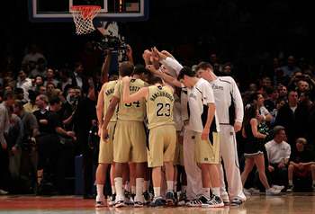 NEW YORK, NY - MARCH 11: The Notre Dame Fighting Irish huddle before their game against the Louisville Cardinals during the semifinals of the 2011 Big East Men's Basketball Tournament presented by American Eagle Outfitters at Madison Square Garden on Marc