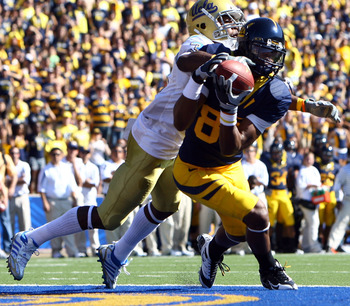 BERKELEY, CA - OCTOBER 25:  Wide receiver LaReylle Cunningham #85 of the Cal Golden Bears appears to a make a catch but would later drop it while being defended by by Rahim Moore #3 of the UCLA Bruins during the first quarter at Memorial Stadium on Octobe