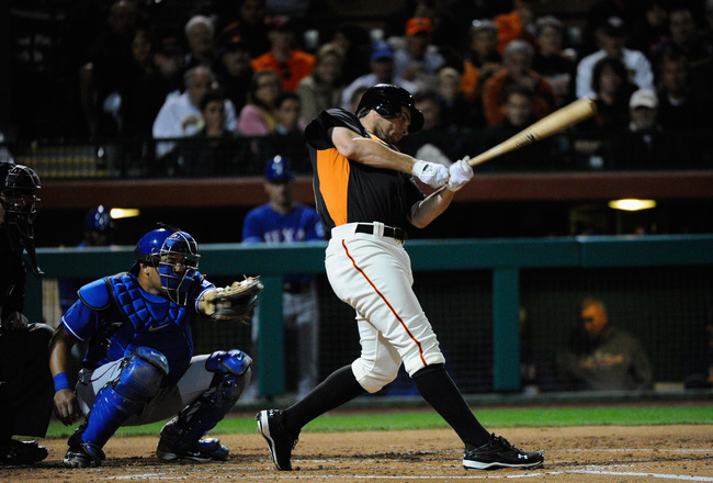 SCOTTSDALE, AZ - MARCH 07:  Brandon Belt #9 of the San Francisco Giants swings the bat against the Texas Rangers during the exhibition baseball game in the first meeting between the two teams since the World Series at Scottsdale Stadium on March 7, 2011 i