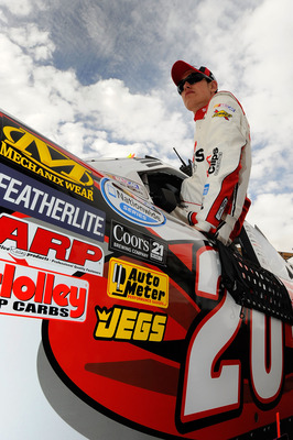 AVONDALE, AZ - FEBRUARY 26:  Joey Logano, driver of the #20 SportClips Toyota, climbs in his car prior to the NASCAR Nationwide Series Bashas' Supermarkets 200 at Phoenix International Raceway on February 26, 2011 in Avondale, Arizona.  (Photo by Jared C.