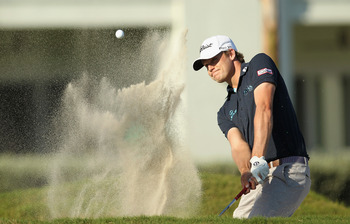 DORAL, FL - MARCH 13:  Nick Watney hits a bunker shot on the 13th hole during the final round of the 2011 WGC- Cadillac Championship at the TPC Blue Monster at the Doral Golf Resort and Spa on March 13, 2011 in Doral, Florida.  (Photo by Mike Ehrmann/Gett
