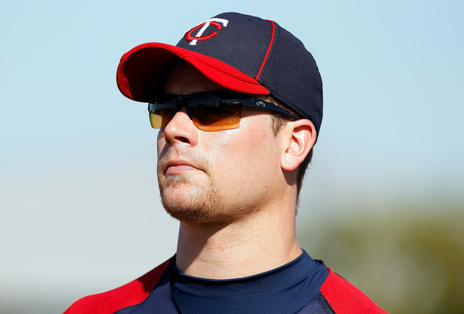 FORT MYERS, FL - FEBRUARY 23:  Infielder Justin Morneau #33 of the Minnesota Twins warms up during a spring training workout session at Hammond Stadium on February 23, 2011 in Fort Myers, Florida.  (Photo by J. Meric/Getty Images)