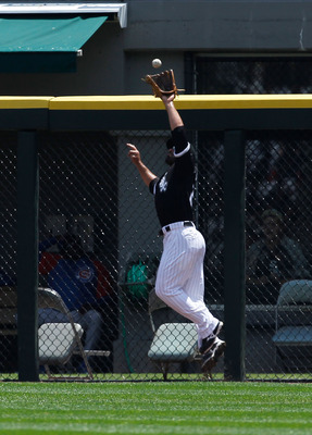 CHICAGO - JUNE 27: Carlos Quentin #20 of the Chicago White Sox leaps to catch a fly ball at the fence against the Chicago Cubs at U.S. Cellular Field on June 27, 2010 in Chicago, Illinois. The Cubs defeated the White Sox 8-6. (Photo by Jonathan Daniel/Get