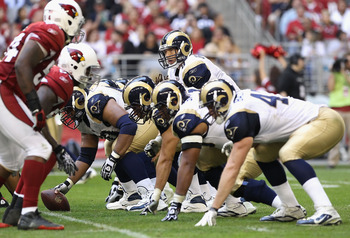 GLENDALE, AZ - DECEMBER 05:  Quarterback Sam Bradford #8 of the St. Louis Rams snaps the football during the NFL game against the Arizona Cardinals at the University of Phoenix Stadium on December 5, 2010 in Glendale, Arizona. The Rams defeated the Cardin