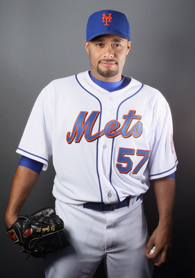 PORT ST. LUCIE, FL - FEBRUARY 24:  Johan Santana #57 of the New York Mets poses for a portrait during the New York Mets Photo Day on February 24, 2011 at Digital Domain Park in Port St. Lucie, Florida.  (Photo by Elsa/Getty Images)