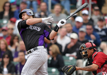 SCOTTSDALE, AZ - FEBRUARY 26:  Chris Iannetta #20 of the Colorado Rockies swings against the game against the Arizona Diamondbacks at Salt River Fields on February 26, 2011in Scottsdale, Arizona..  (Photo by Jonathan Ferrey/Getty Images)