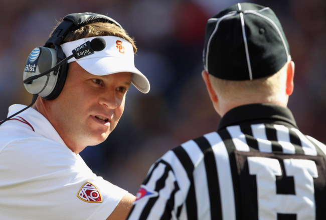 MINNEAPOLIS - SEPTEMBER 18:  Head coach Lane Kiffin of the USC Trojans appeals to linesman Jim Ryan during the game against the Minnesota Golden Gophers on September 18, 2010 at TCF Bank Stadium in Minneapolis, Minnesota.  (Photo by Jamie Squire/Getty Ima