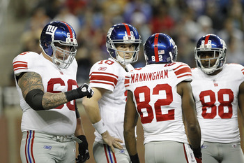 DETROIT, MI - DECEMBER 13: Eli Manning #10 of the New York Giants with teammates Dave Diehl #66 Mario Manningham #82 and Hakeem Nicks #88 during the game against the Minnesota Vikings at Ford Field on December 13, 2010 in Detroit, Michigan.  (Photo by Leo