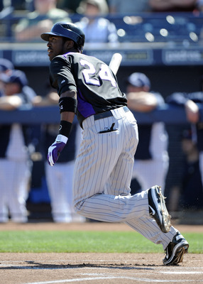 PEORIA, AZ - MARCH 02:  Dexter Fowler #24 of the Colorado Rockies at bat against the San Diego Padres during spring training at Peoria Stadium on March 2, 2011 in Peoria, Arizona.  (Photo by Harry How/Getty Images)