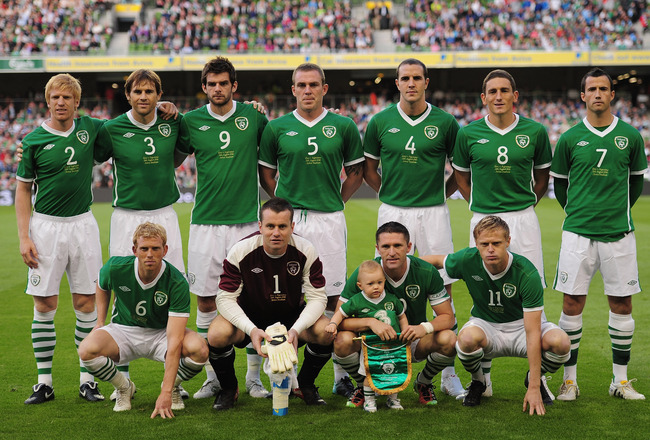 DUBLIN, IRELAND - AUGUST 11:  Robbie Keane the Republic of Ireland captain poses with his son Robert and the Republic of Ireland team as he makes his 100th appearance during the International Friendly match between Republic of Ireland and Argentina at the