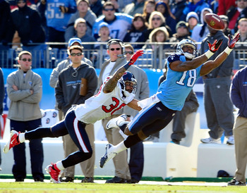 NASHVILLE, TN - DECEMBER 19:  Jason Allen #20 of the Houston Texans defends a pass to Kenny Britt #18 of the Tennessee Titans  during the first half at LP Field on December 19, 2010 in Nashville, Tennessee.  (Photo by Grant Halverson/Getty Images)