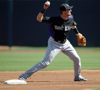 PEORIA, AZ - MARCH 02:  Troy Tulowitzki #2 of the Colorado Rockies makes a throw to first against the San Diego Padres during spring training at Peoria Stadium on March 2, 2011 in Peoria, Arizona.  (Photo by Harry How/Getty Images)