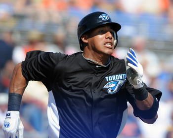 DUNEDIN, FL - FEBRUARY 26:  Outfielder Rajai Davis #11 of the Toronto Blue Jays runs to first base against the Detroit Tigers February 26, 2011 at Florida Auto Exchange Stadium in Dunedin, Florida.  (Photo by Al Messerschmidt/Getty Images)