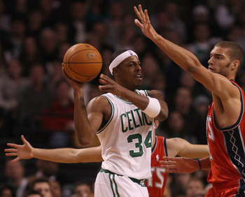 BOSTON - NOVEMBER 24:  Paul Pierce #34 of the Boston Celtics tries to pass around Brook Lopez #11 of the New Jersey Nets on November 24, 2010 at the TD Garden in Boston, Massachusetts. The Celtics defeated the nets 89-83. NOTE TO USER: User expressly ackn