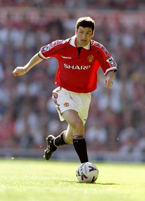 15 Aug 1998:  Denis Irwin of Manchester United in action during the FA Carling Premiership match against Leicester City at Old Trafford in Manchester, England. The game ended 2-2. \ Mandatory Credit: Shaun Botterill /Allsport