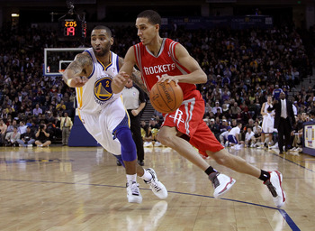 OAKLAND, CA - DECEMBER 20:  Kevin Martin #12 of the Houston Rockets dribbles past Acie Law #2 of the Golden State Warriors at Oracle Arena on December 20, 2010 in Oakland, California. NOTE TO USER: User expressly acknowledges and agrees that, by downloadi