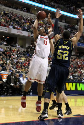 INDIANAPOLIS, IN - MARCH 12:  Jared Sullinger #0 of the Ohio State Buckeyes attempts a shot against Jordan Morgan #52 of the Michigan Wolverines during the semifinals of the 2011 Big Ten Men's Basketball Tournament at Conseco Fieldhouse on March 12, 2011