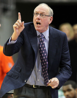 LOUISVILLE, KY - FEBRUARY 12:  Jim Boeheim the Head Coach of the Syracuse Orange gives instructions to his team during the Big East Conference game against the Louisville Cardinals at the KFC Yum! Center on February 12, 2011 in Louisville, Kentucky.  Loui