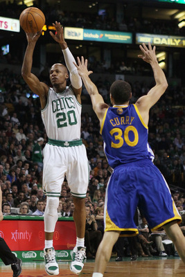 BOSTON, MA - MARCH 04:  Ray Allen #20 of the Boston Celtics takes a shot as Stephen Curry #30 of the Golden State Warriors defends on March 4, 2011 at the TD Garden in Boston, Massachusetts.  NOTE TO USER: User expressly acknowledges and agrees that, by d