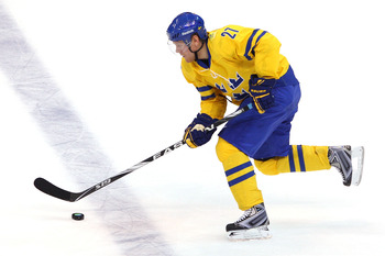 VANCOUVER, BC - FEBRUARY 24:  Patric Hornqvist #27 of Sweden moves the puck during the ice hockey men's quarter final game between Sweden and Slovakia on day 13 of the Vancouver 2010 Winter Olympics at Canada Hockey Place on February 24, 2010 in Vancouver