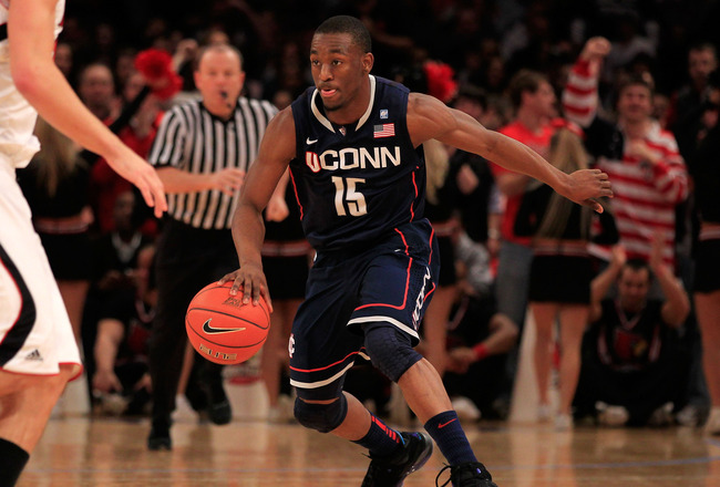 NEW YORK, NY - MARCH 12: Kemba Walker #15 of the Connecticut Huskies dribbles up court against the Louisville Cardinals during the championship of the 2011 Big East Men's Basketball Tournament presented by American Eagle Outfitters at Madison Square Garde
