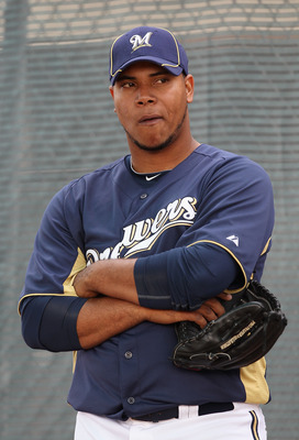 PHOENIX, AZ - FEBRUARY 18:  Pitcher Wily Peralta #73 of the Milwaukee Brewers listens to coaches during a MLB spring training practice at Maryvale Baseball Park on February 18, 2011 in Phoenix, Arizona.  (Photo by Christian Petersen/Getty Images)