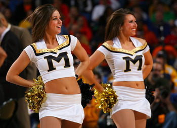BUFFALO, NY - MARCH 21:  Cheerleaders for the Missouri Tigers perform during a timeout against the West Virginia Mountaineers during the second round of the 2010 NCAA men's basketball tournament at HSBC Arena at HSBC Arena on March 21, 2010 in Buffalo, Ne