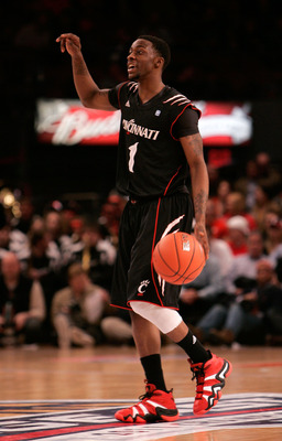 NEW YORK, NY - MARCH 10:  Cashmere Wright #1 of the Cincinnati Bearcats brings the ball up court against the Notre Dame Fighting Irish during the quarterfinals of the 2011 Big East Men's Basketball Tournament presented by American Eagle Outfitters  at Mad