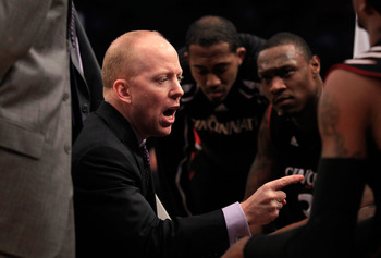 NEW YORK, NY - MARCH 10: Head coach Mick Cronin of the Cincinnati Bearcats speaks to players during a time out in the first half against the Notre Dame Fighting Irish during the quarterfinals of the 2011 Big East Men's Basketball Tournament presented by A