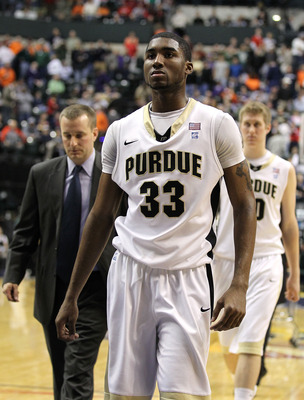 INDIANAPOLIS, IN - MARCH 11:  E'Twaun Moore #33 of the Purdue Boilermakers  walks off the court dejected after they lost 74-56 against the Michigan State Spartans during the quarterfinals of the 2011 Big Ten Men's Basketball Tournament at Conseco Fieldhou