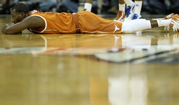 KANSAS CITY, MO - MARCH 12:  Jordan Hamilton #3 of the Texas Longhorns lays on the court after a play against the Kansas Jayhawks during the 2011 Phillips 66 Big 12 Men's Basketball Tournament championship game at Sprint Center on March 12, 2011 in Kansas