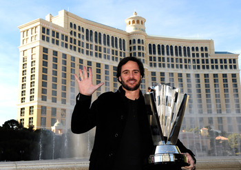 LAS VEGAS, NV - NOVEMBER 30:  Five-time NASCAR Sprint Cup Series Champion Jimmie Johnson poses with the 2010 trophy outside the Bellagio Hotel and Casino Resort during Day 1 of the NASCAR Sprint Cup Series Champions Week on November 30, 2010 in Las Vegas,