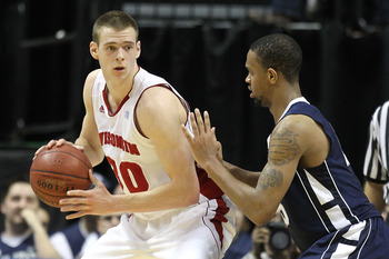 INDIANAPOLIS, IN - MARCH 11:  Jon Leuer #30 of the Wisconsin Badgers posts up against David Jackson #15 of the Penn State Nittany Lions during the quarterfinals of the 2011 Big Ten Men's Basketball Tournament at Conseco Fieldhouse on March 11, 2011 in Ind