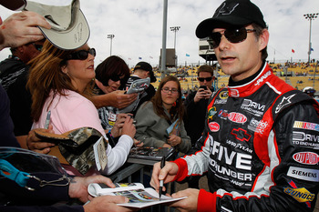 AVONDALE, AZ - FEBRUARY 26:  Jeff Gordon, driver of the #24 Drive to End Hunger Chevrolet, signs autographs for fans during qualifying for the NASCAR Sprint Cup Series Subway Fresh Fit 500 at Phoenix International Raceway on February 26, 2011 in Avondale,