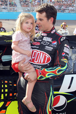PHOENIX - APRIL 10:  Jeff Gordon, driver of the #24 DuPont Chevrolet, holds daughter Ella Sophia Gordon prior to the NASCAR Sprint Cup Series SUBWAY Fresh Fit 600 at Phoenix International Raceway on April 10, 2010 in Phoenix, Arizona.  (Photo by Christian