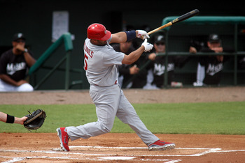 JUPITER, FL - MARCH 06:  First baseman Albert Pujols #5 of the St. Louis Cardinals bats against the Florida Marlins at Roger Dean Stadium on March 6, 2011 in Jupiter, Florida.  (Photo by Marc Serota/Getty Images)