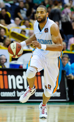 TOWNSVILLE, AUSTRALIA - JANUARY 28:  Ira Clark of the Blaze dribbles the ball during the round 16 NBL match between the Townsville Crocodiles and the Gold Coast Blaze at Townsville Entertainment Centre on January 28, 2011 in Townsville, Australia.  (Photo