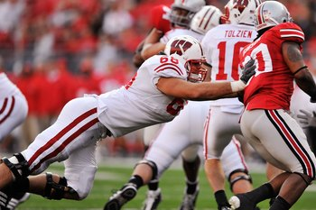 COLUMBUS, OH - OCTOBER 10:  Offensive lineman Gabe Carimi #68 of the Wisconsin Badgers blocks against the Ohio State Buckeyes at Ohio Stadium on October 10, 2009 in Columbus, Ohio.  (Photo by Jamie Sabau/Getty Images)