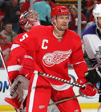 DETROIT, MI - MARCH 9:  Dustin Penner #25 of the Los Angeles Kings is held in check by Nicklas Lidstrom #5 of the Detroit Red Wings in a game on March 9, 2011 at the Joe Louis Arena in Detroit, Michigan. The Kings defeated the Wings 2-1. (Photo by Claus A