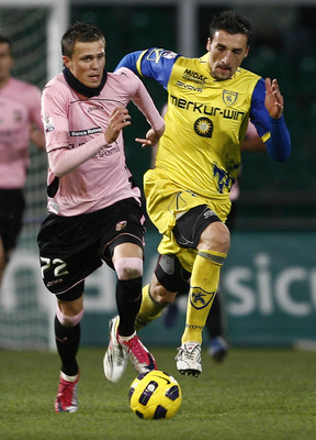 PALERMO, ITALY - JANUARY 12: Josip Ilicic (L) of Palermo and Gennaro Sardo of Palermo compete for the ball during the Tim Cup match between Palermo and Chievo Verona at Stadio Renzo Barbera on January 12, 2011 in Palermo, Italy.  (Photo by Tullio M. Pugli