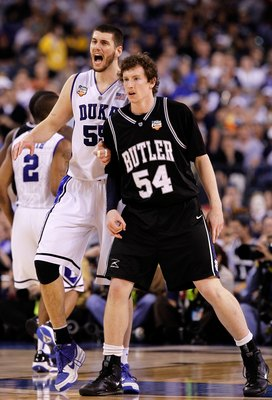 INDIANAPOLIS - APRIL 05:  Brian Zoubek #55 of the Duke Blue Devils reacts as he matches up against Matt Howard #54 of the Butler Bulldogs during the 2010 NCAA Division I Men's Basketball National Championship game at Lucas Oil Stadium on April 5, 2010 in