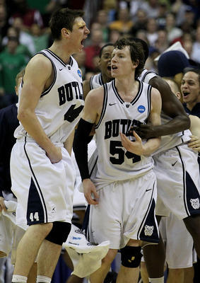 WASHINGTON - MARCH 17:  Andrew Smith #44 and Matt Howard #54 of the Butler Bulldogs celebrate defeating the Old Dominion Monarchs 60-58 during the second round of the 2011 NCAA men's basketball tournament at the Verizon Center on March 17, 2011 in Washing