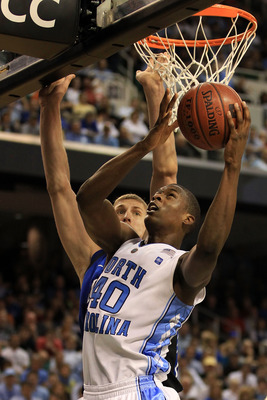 GREENSBORO, NC - MARCH 13:  Harrison Barnes #40 of the North Carolina Tar Heels shoots against Mason Plumlee #5 of the Duke Blue Devils during the second half in the championship game of the 2011 ACC men's basketball tournament at the Greensboro Coliseum