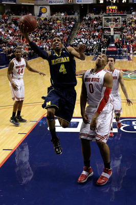 INDIANAPOLIS, IN - MARCH 12:  Darius Morris #4 of the Michigan Wolverines drives for a shot attempt against Jared Sullinger #0 of the Ohio State Buckeyes during the semifinals of the 2011 Big Ten Men's Basketball Tournament at Conseco Fieldhouse on March